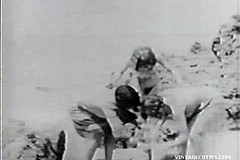 / Vintage Video of a First Glory Hole Scene where a Man Spies on Nude Women on the Beach and then Uses a Hole and His Cock