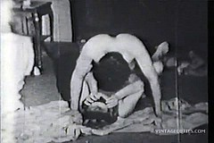 / Bisexual Threesome in a Vintage Porn Video Having a Good Time Fucking and Sucking Cocks on a Floor in 1960s